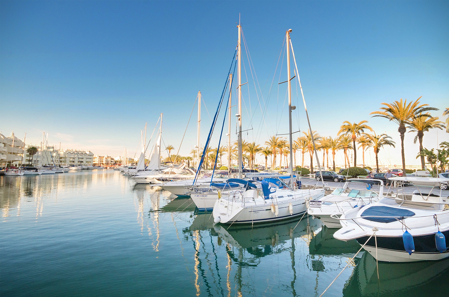 Scenic view of some Yachts in Marina port at dusk in Benalmádena